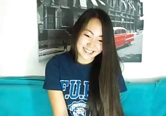 Cute Asian babe gets naked on webcam - 7 min
