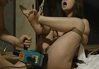 Tied up Japanese hottie fucked with a machine - 8 min