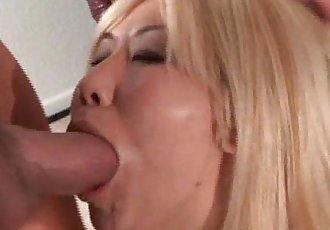 Attractive blonde Asian MILF sucks huge
