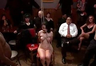 Zippered tied up babe throat fucked in public bar - 5 min
