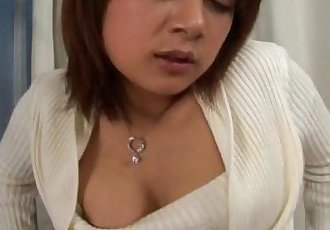 Asian babe with a hairy muff pleases herself - 7 min
