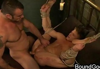 Bound gay giving blowjob to his partner and gets fucked from him in bed