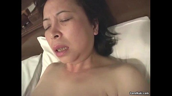 Asian granny masturbates