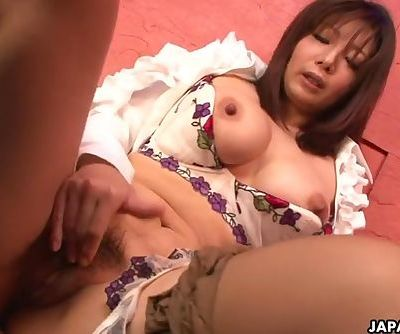 Yummy Japanese babe plays with her hairy snatch