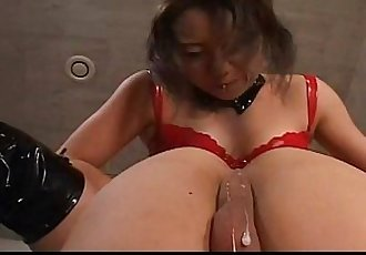 Horny Japanese MiLF in red latex with a strap on does some damage - 7 min
