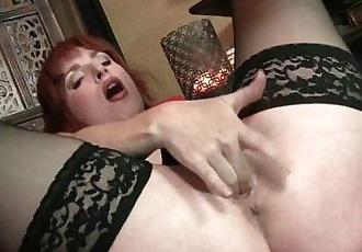 Redheaded milf Amber Dawn looks so slutty in black lingerieHD