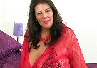 British milf Lulu Lush peels off her red fishnet stockingsHD