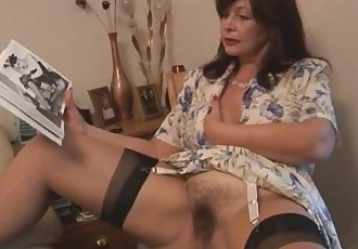 Busty hairy mature brunette babe poses and strips