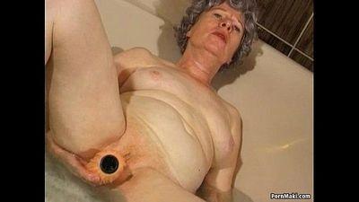 Granny masturbates with a vibrator in bathtub - 1 min 30 sec