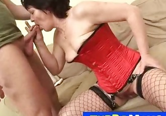 Elder hairy mom Eva wears fishnet stockings during a sex with a boy