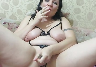 smokes and fucks herself with a bottle