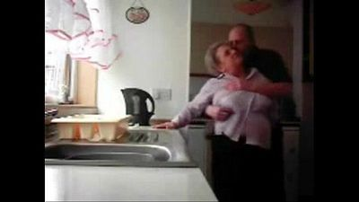 LOL. Mum and daddy caught having fun in the kitchen. Hidden cam - 3 min
