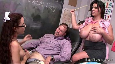 Teen with glasses gives handjob in threesome