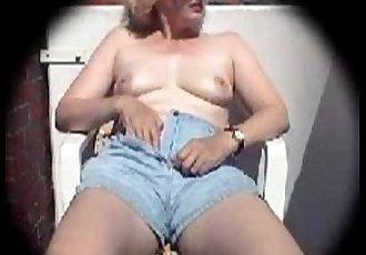 Blonde Caroline fingering in the backyard - 5 min