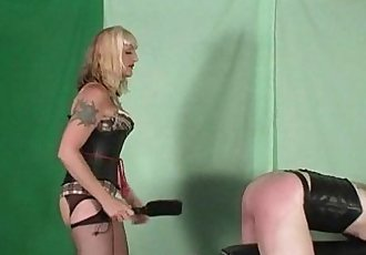 Mistress Kelly spanks and paddles her slave on the spanking horse - 3 min