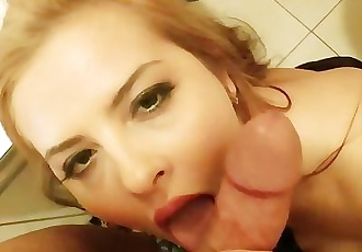 Busty girl stimulates cock with her massive breasts