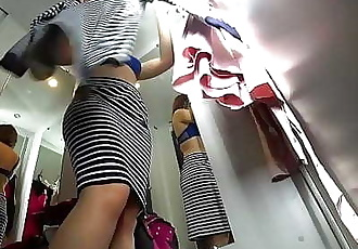 Peeping into the public dressing room, a view from below on a juicy ass and on a sexy girl with long legs, hidden..