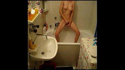 My hidden cam caught my nice sister fingering in bath room - 1 min 20 sec