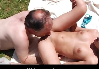 Old guy gives cunnilingus to young girl in the park