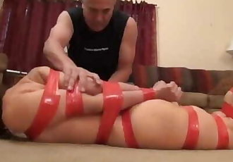 Brooke Lady in Red tape bondage