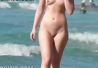 Candid young blonde naked on the nude beach shower her shaved pussy!