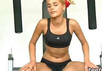 sporty blonde with small tits in the gym