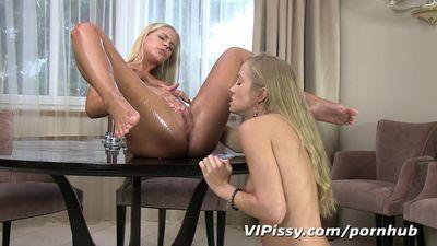 Hot blonde babes swap golden showers