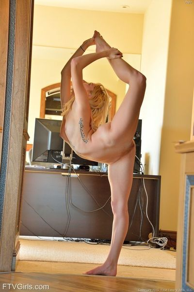 Acrobatic sexy blonde with tattoo stretches legs & toys with huge dildo