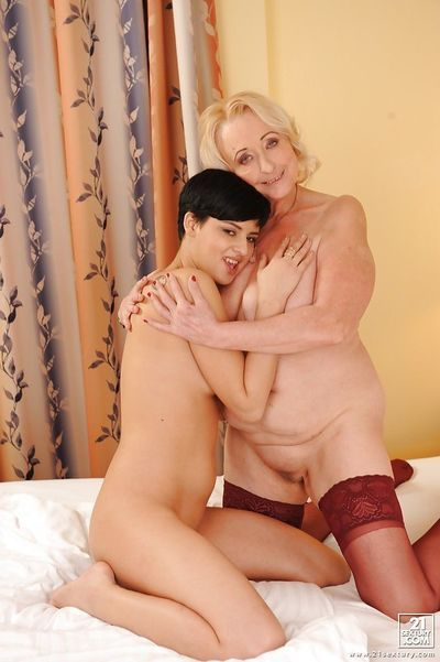 Teenage sweetie has some lesbian fun with her horny mature friend - part 2