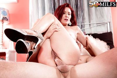 Small boobed mature redhead Dana Devereaux taking hardcore facial cumshot - part 2