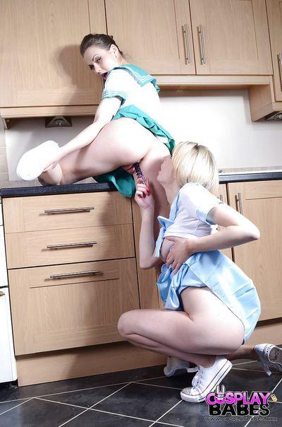 Cute coed cheerleaders Jessica Jensen and Tina Kay licking bald slits