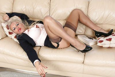 Curvy blonde lady in pantyhose flashing thigh and garters while smoking - part 2