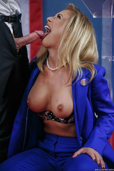 Blonde MILF pornstar Cherie Deville baring big boobs while blowing cock