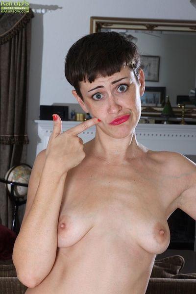 Leggy short haired skinny babe Stevie Jones stripping naked