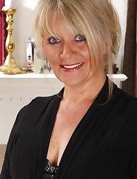 Mature blondie Aubrey Adams is teasing her hairy old cunt on camera