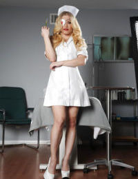 Busty blonde nurse Ash Hollywood undressing for nude photos
