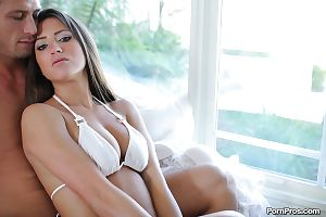 Slender brunette Lizz Tayler is riding on the hard dong so sweet
