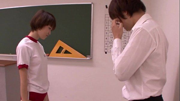 Young oriental schoolgirl blowing teacher