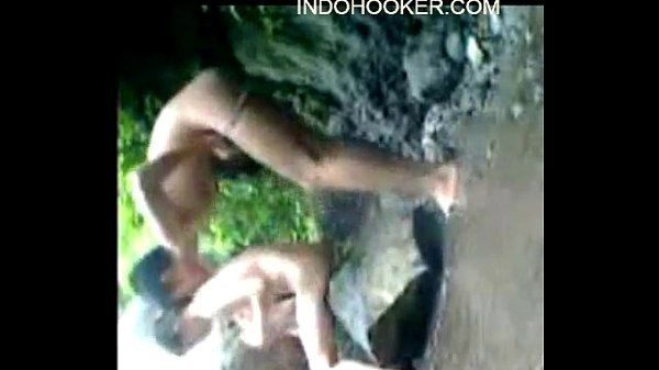 Teen couple having sex beside the river