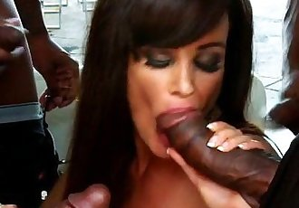 Lisa Ann sucks four big black cocks at the same time