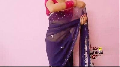 young indian wife teaching how to wear saree - 1 min 4 sec