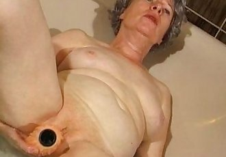 Granny masturbates with a vibrator in bathtub - 1 min 30 sec