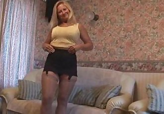 Mature blonde with great body in tight mini skirt - 2 min