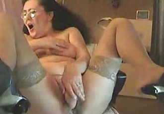 Old granny dildoing on cam - 1 min 27 sec