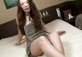 Asian milf uses vibrator and loves it