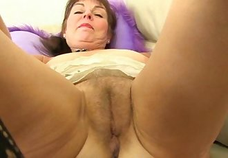 British granny Georgie fingers her ass