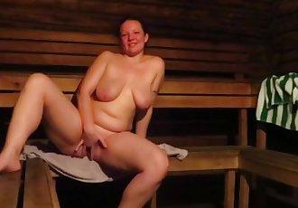 milf with big tits, masturbating in the sauna