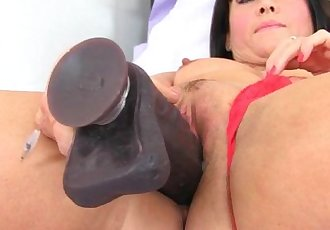 British milf Lelani loves her big black dildos