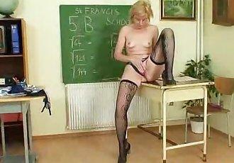 Dame teacher masturbates herself after a class